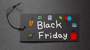 Black Friday text on a black tag on black paper background