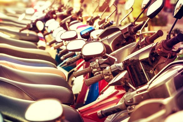 Retro filtered picture of scooter in a row.