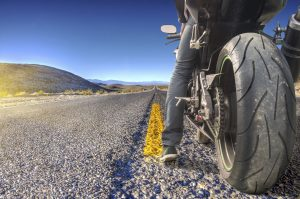 Road crossing the Death Valley with motorbike